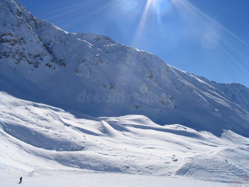 Lone skiier in Vallandry stock image