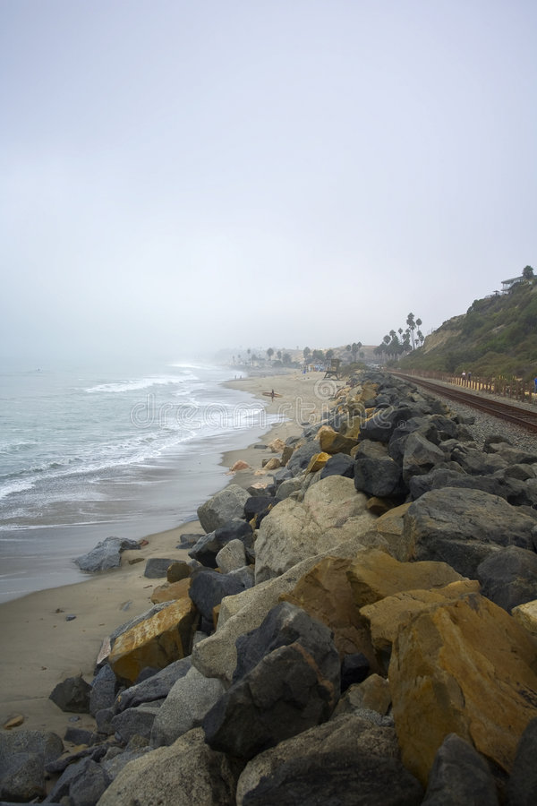 Lone Surfer in San Clemente on a Foggy Day. At 204's stock image