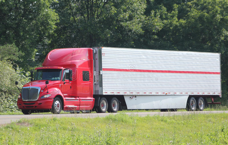 Lone tractor-trailer on an interstate highway. royalty free stock photo
