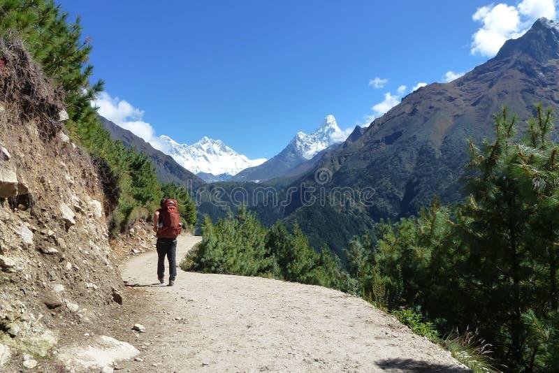 A trekker with the Ama Dablam on the background, Namche Bazaar, Everest Base Camp trek, Nepal stock image