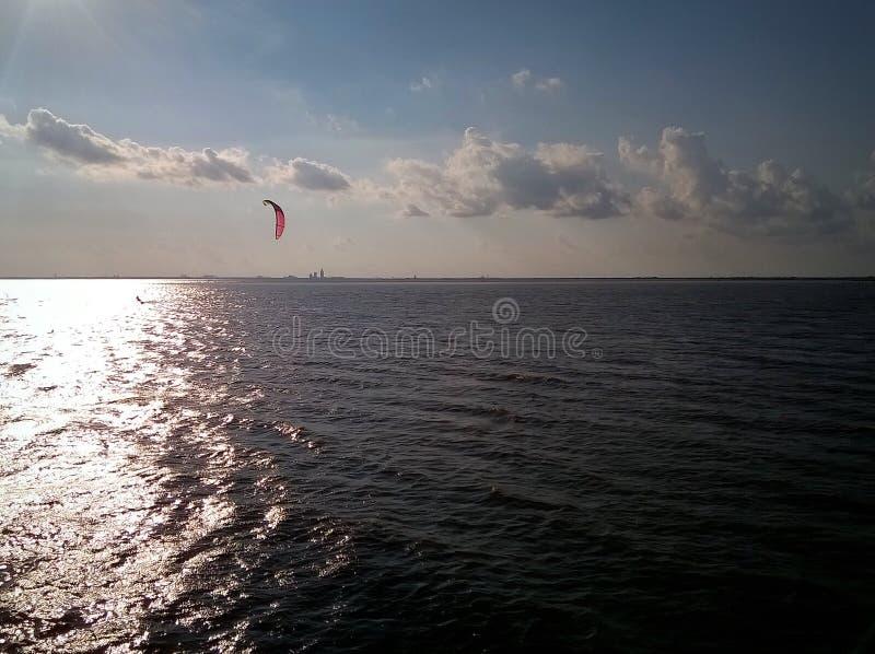 Lone windsurfer 2 stock photo