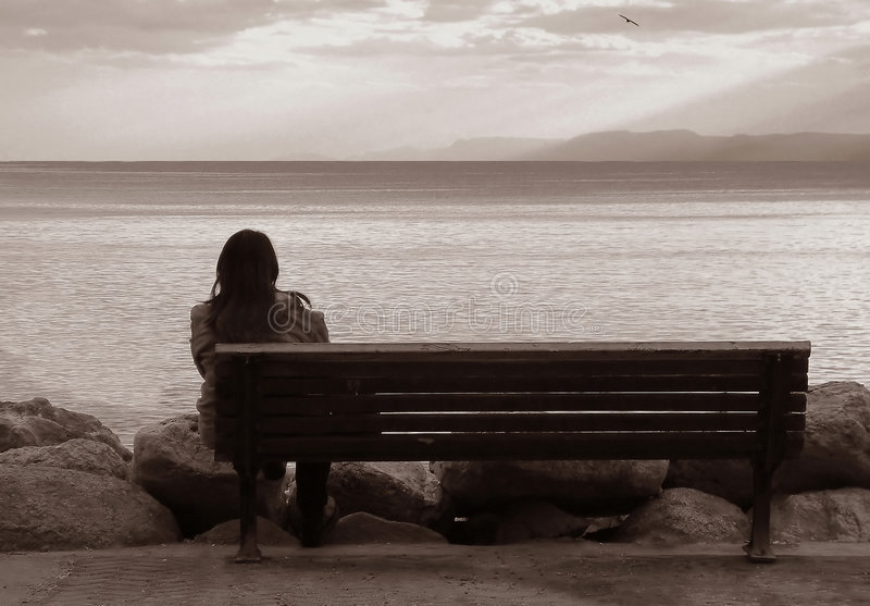 Lone woman on the bench. stock photo