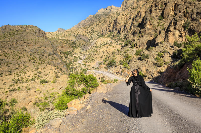 Lone woman on a mountain road stock photography