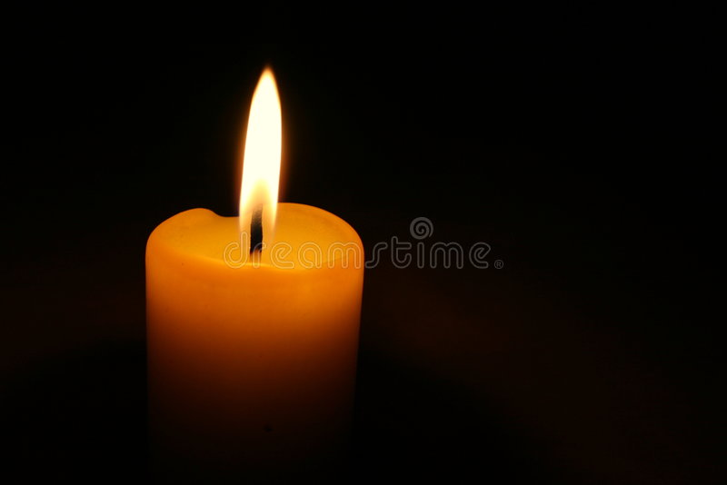 Lone yellow candle stock images