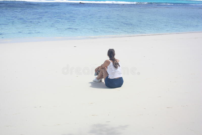Loneliness on beach royalty free stock photo