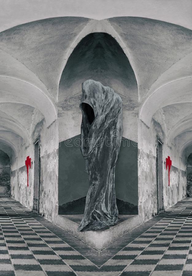 Loneliness - Hooded Figure in the castle. Hooded Figure in the castle without faces. The light comes out of the face of Hooded Figure royalty free stock images