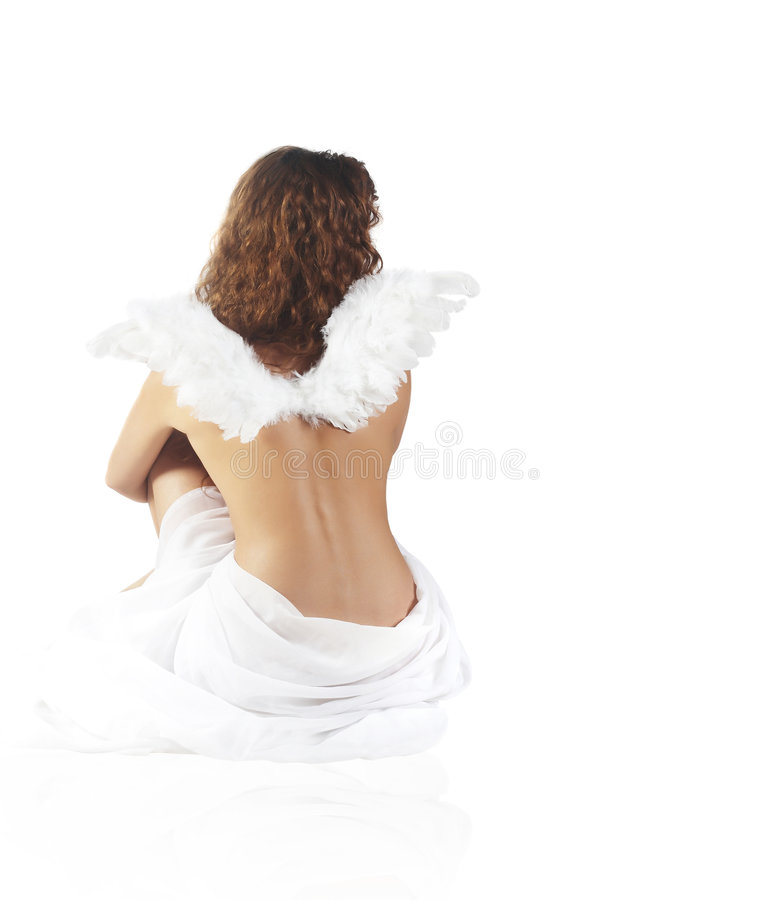 Lonely angel. The beautiful girl with wings of the angel stock photos