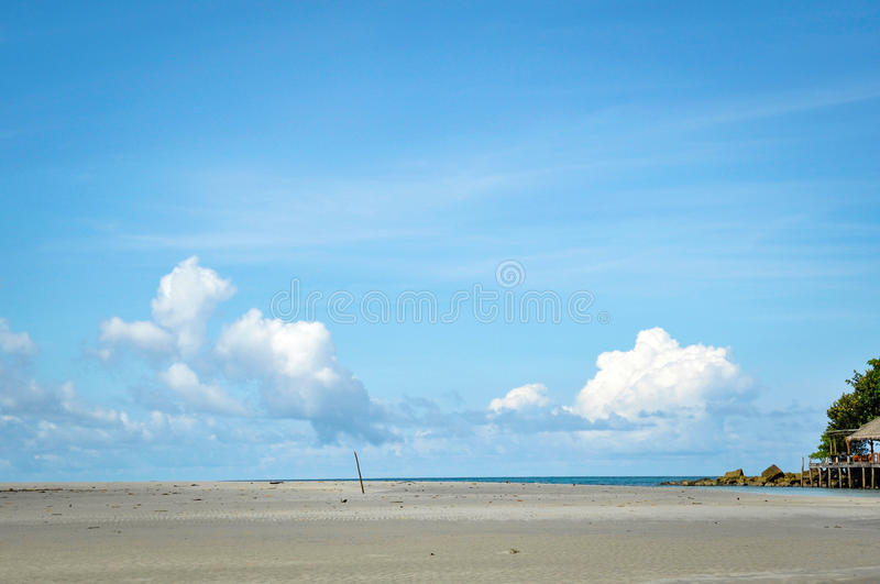 Lonely beach with the sea and blue sky royalty free stock photos