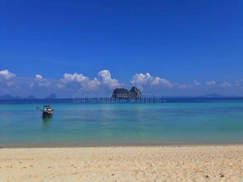 Lonely beach in Thailand. Lonely beach without tourists and magic blue water - Thailand stock images