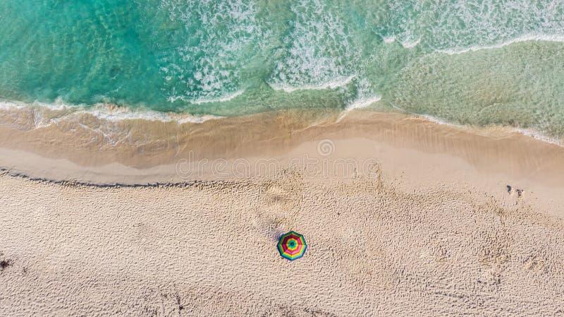 Lonely beach umbrella at Tulum beach Mexico North America. Lonely beach umbrella at Tulum beach in  Mexico North America royalty free stock image