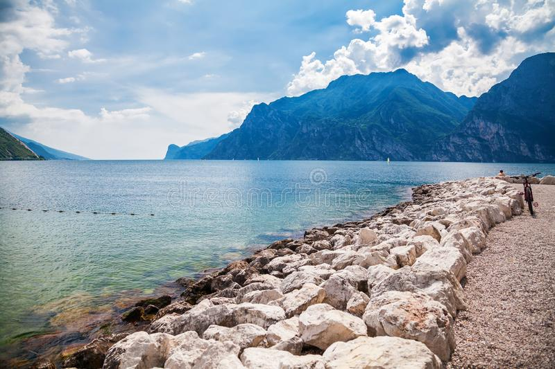 Lonely beach in a village Torbole. Beautiful view of the lonely beach in a village Torbole, Garda lake, Italy royalty free stock image