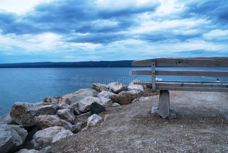 Approaching storm. Lonely bench near the sea. Approaching storm stock photos