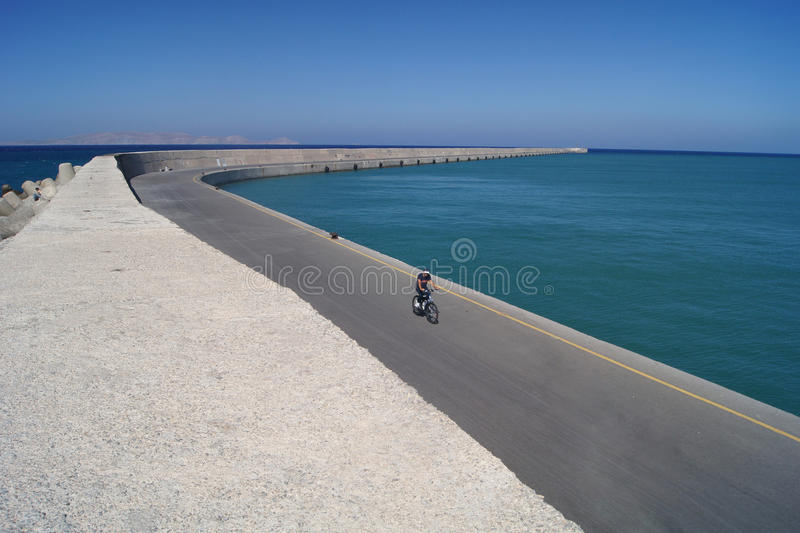 Download The Lonely Bicyclist In Heraklion Stock Image - Image: 21393365