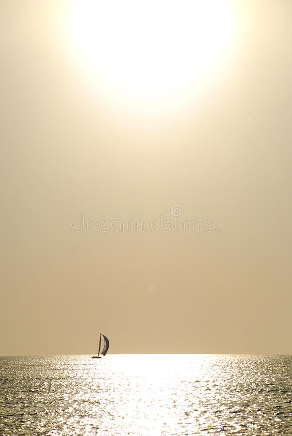 Free Lonely Boat Against The Sun Royalty Free Stock Image - 16131336