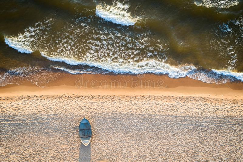 Lonely boat on a beach with aerial view royalty free stock photo