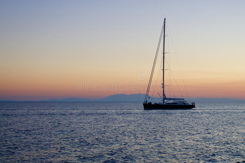 Lonely boat on a calm sea royalty free stock photography