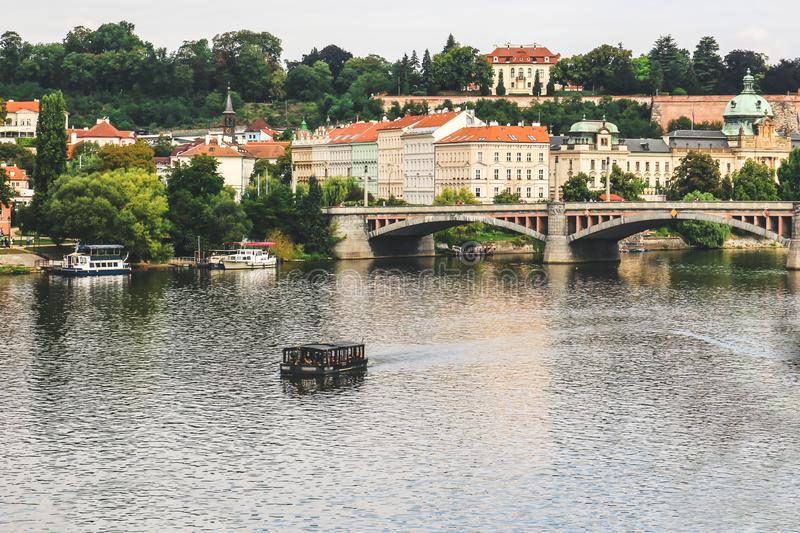 Lonely boat floating with people on the river. Prague Czech Republic royalty free stock photos