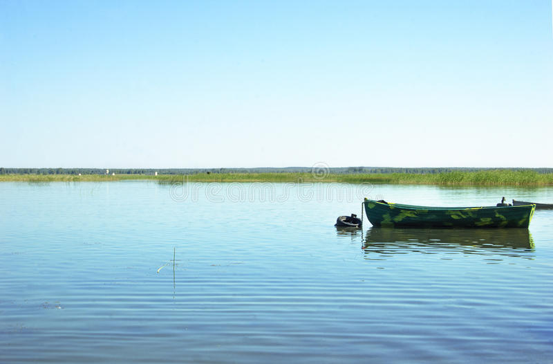 Lonely boat on the lake. stock images