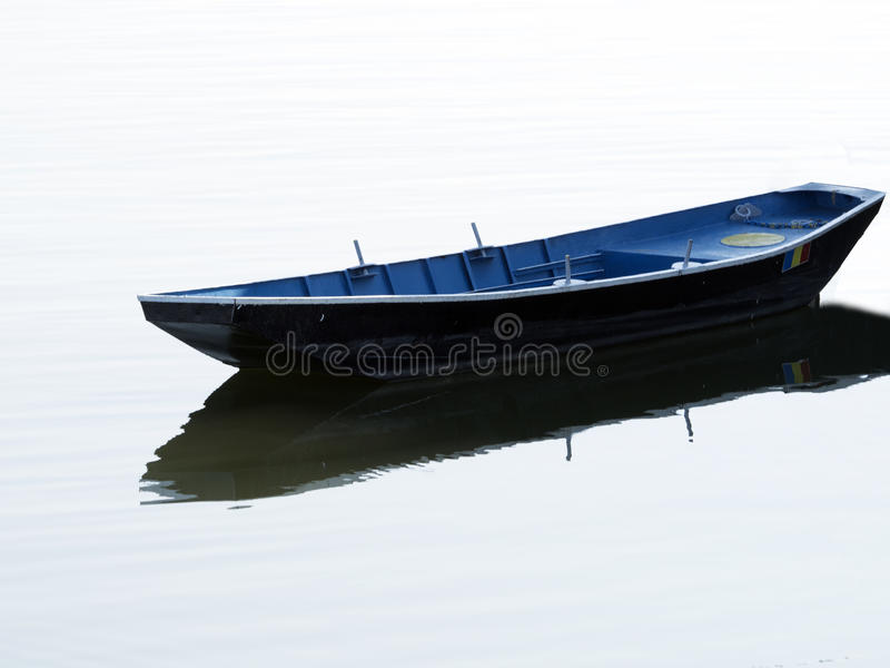 Lonely boat royalty free stock photos