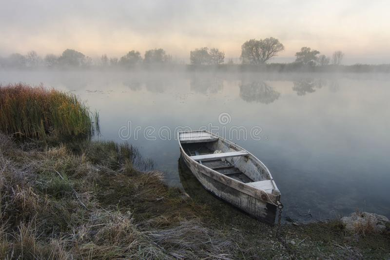 Lonely boat by the river stock photo
