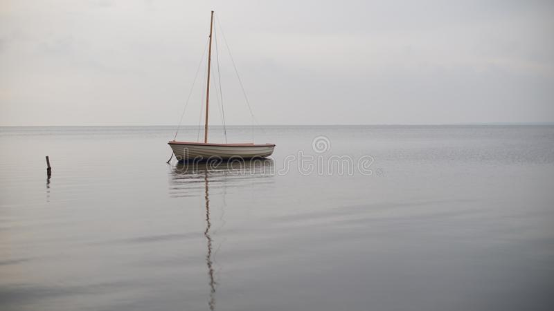 A lonely boat at sea royalty free stock photo