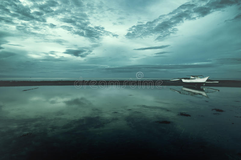 Lonely boat at the sea. Seashore with boat at siquior, philippines royalty free stock photos