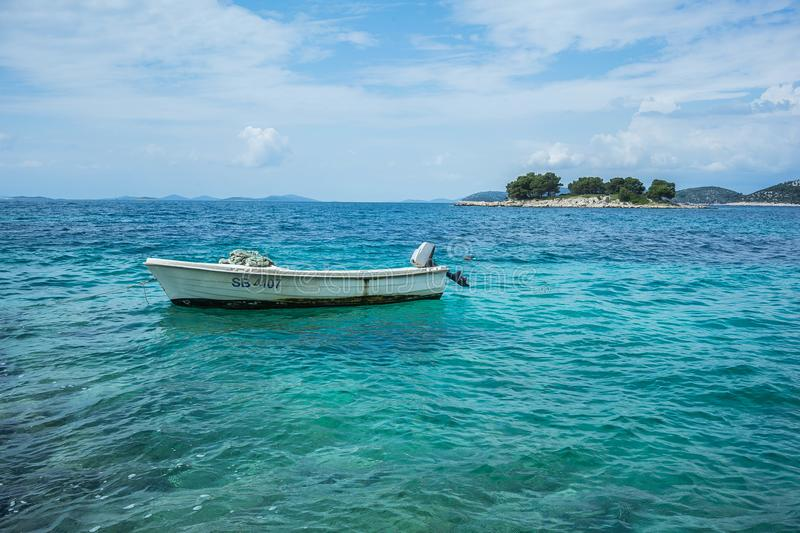 Lonely Boat somewhere in Croatia royalty free stock photo