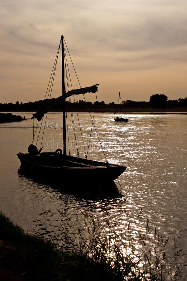 Download Lonely boat at sunset stock image. Image of sunset, silhouette - 20534567