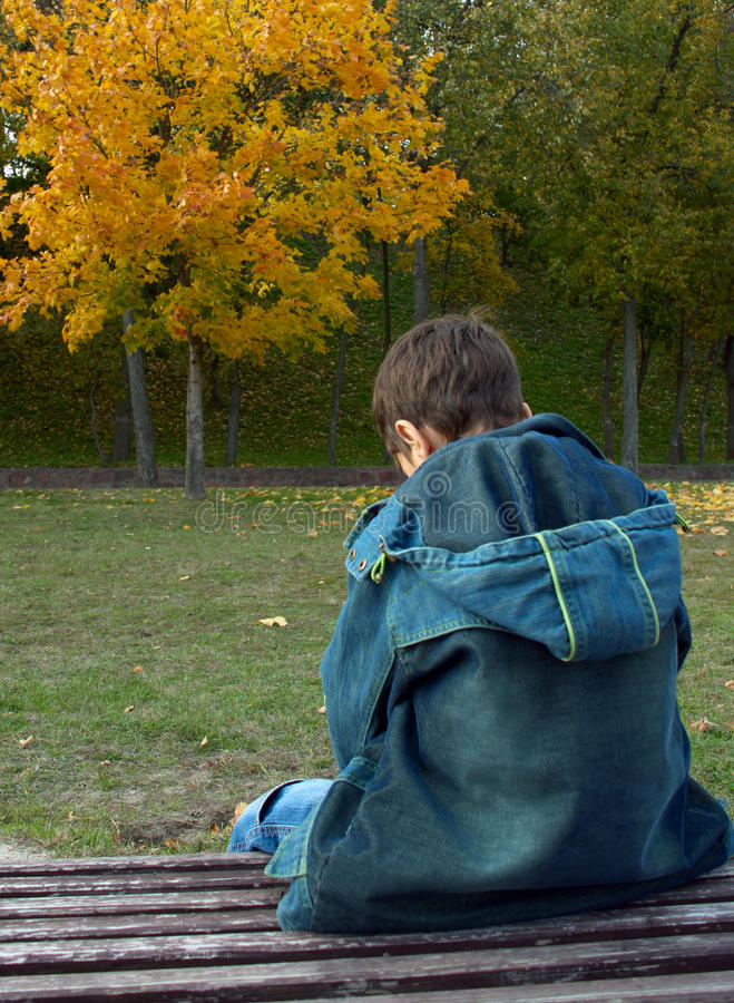 Free Lonely Boy Is Sitting On A Bench Royalty Free Stock Photography - 13062047