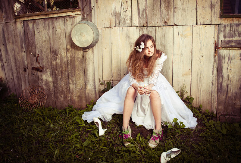 Lonely bride at one with their life problems. Polaroid treatment royalty free stock photos