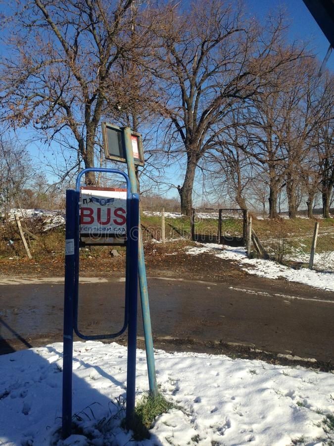Bus stop in the snow. Lonely bus stop in Popovica, Serbia on a sunny, snowy Sunday morning stock photo