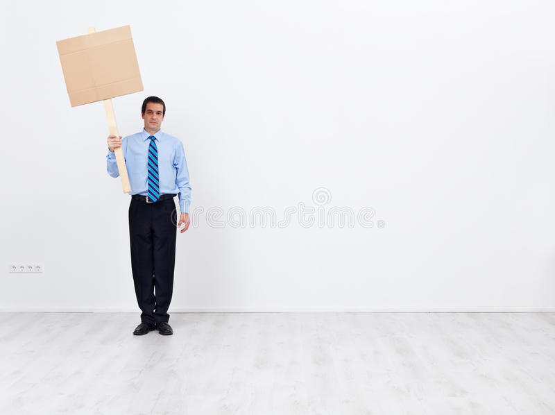 Lonely businessman with empty placard stock images