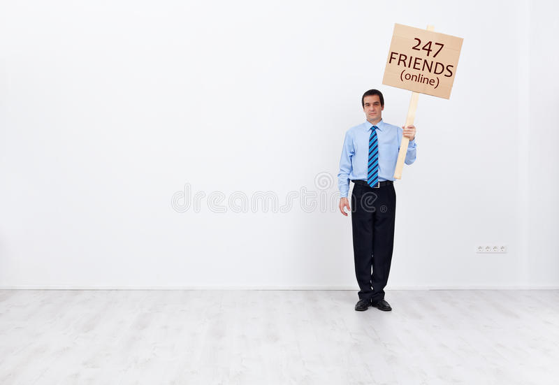 Lonely businessman with many online friends. Lonely businessman with lots of online friends - social life and technology concept stock photography