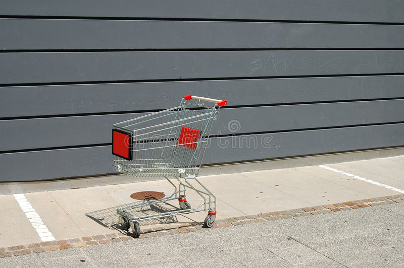 Lonely caddy. Caddy on parking of super market royalty free stock images