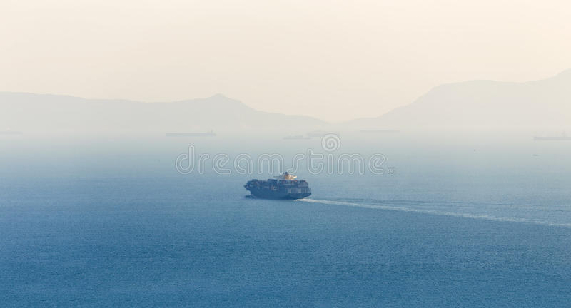 Lonely Cargo Container Ship. In sea royalty free stock photography