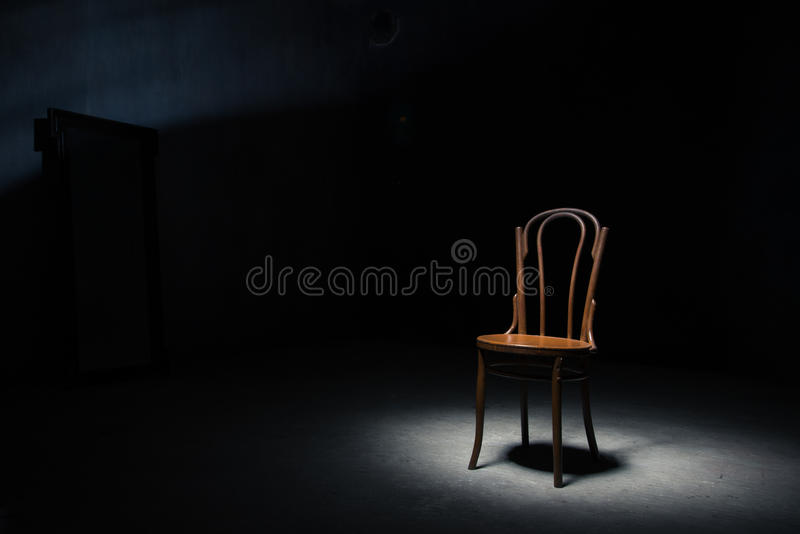 Download Lonely Chair At The Empty Room Stock Photo