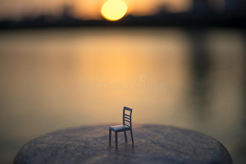 The lonely chair. I have to walk alone by the lake, because my wife have gone foreign country for studding. This lonely chair just like me royalty free stock image