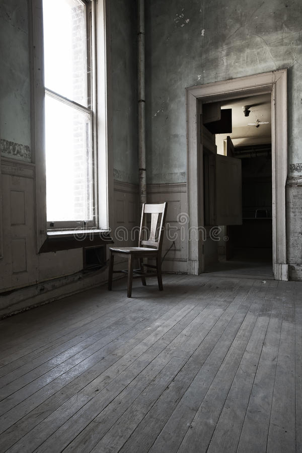 Lonely Chair In Lonely Room Royalty Free Stock Photo