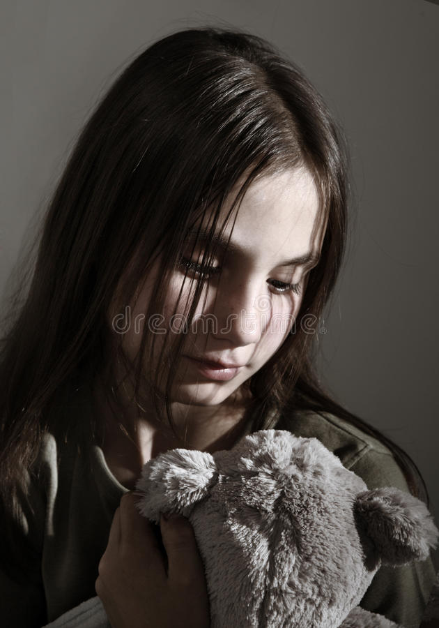 Lonely child with toy royalty free stock image