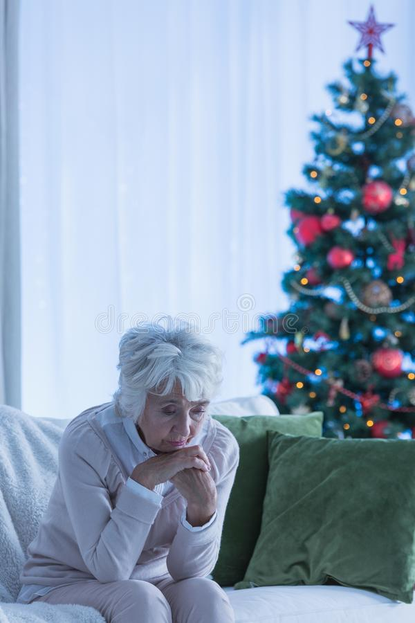 Lonely christmas of a female citizen royalty free stock images