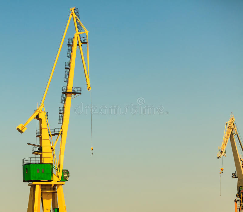 Lonely crane in port. Commerce transport industry cargo machine technology concept. Lonely crane in port. Industrial device in maritime facility royalty free stock image