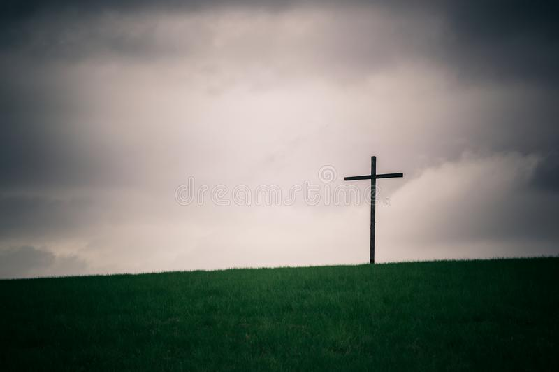 Lonely cross on the horizon series stock photography