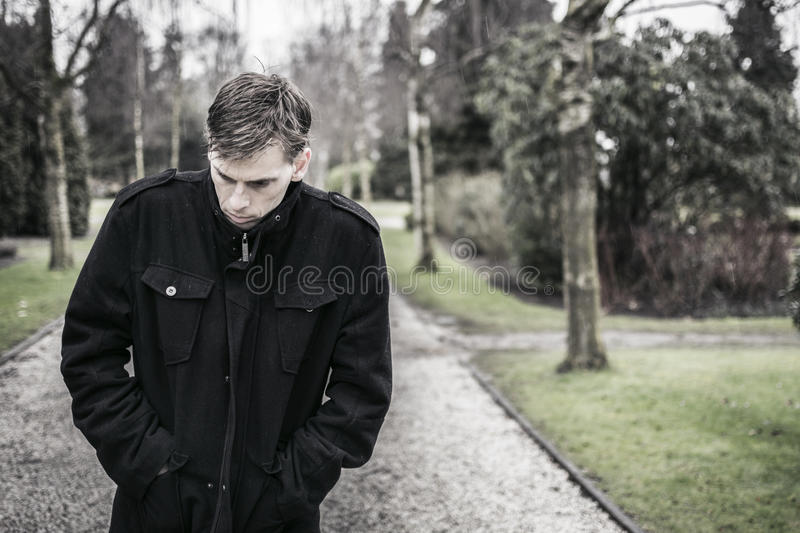 Lonely depressed man outdoors royalty free stock photography