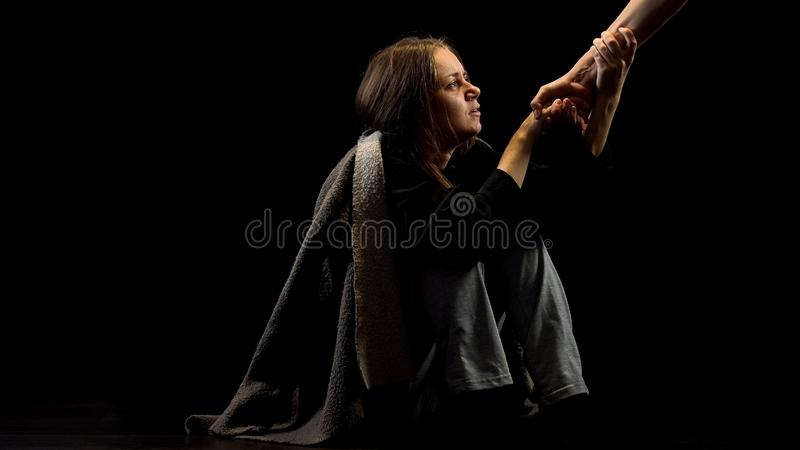 Lonely depressed victim of domestic violence taking helping hand, belief concept. Stock photo stock photography