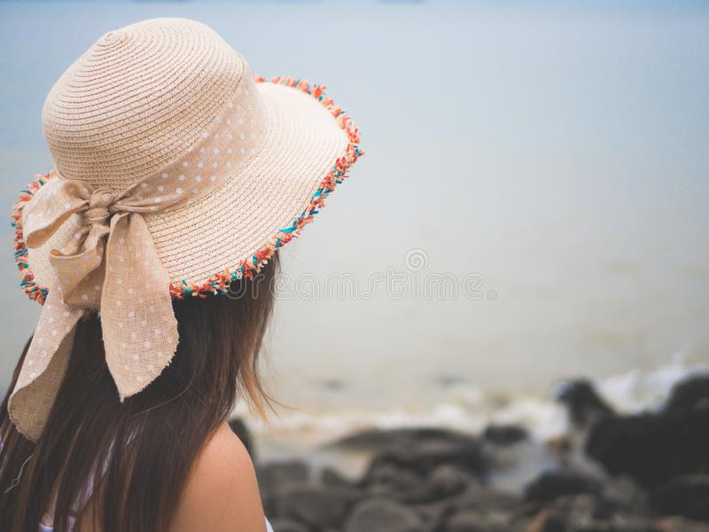Lonely and depressed woman standing in front of the sea i. N a deserted beach on an Autumn day stock photography