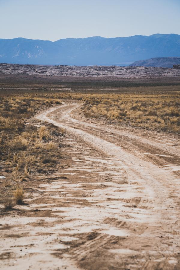 Lonely desert dirt and gravel road in rural New Mexico. In the Four Corners area of the American Southwest royalty free stock photo