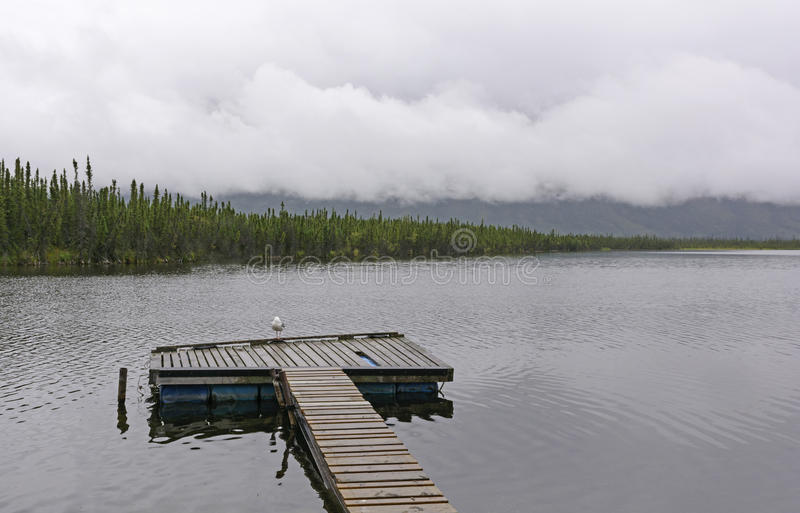 Lonely Dock on a Cloudy Day stock image