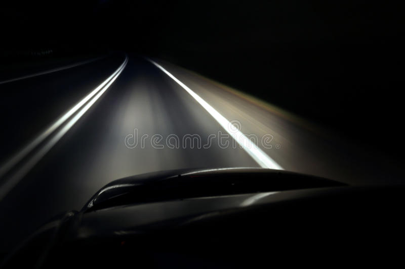 Lonely driving a car at night royalty free stock photography