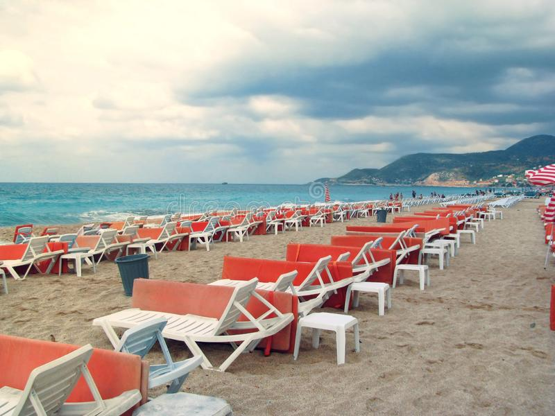 Lonely and empty sun loungers by the sea are waiting for tourists stock photos