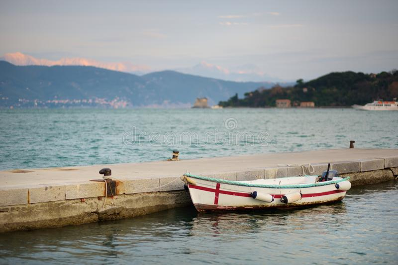 Lonely fishing boat in marina of Porto Venere town, a part of the Italian Riviera, Italy. Lonely fishing boat in marina of Porto Venere town, located in the stock photo